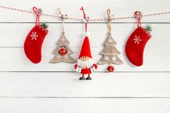 Christmas decoration with Santa and Christmas socks on white woo. Christmas decoration with Santa, red Christmas socks and fir tree on white wooden background royalty free stock photography