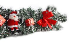 Christmas decoration with Santa Claus. Red boxes and bow Stock Images