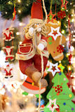 Christmas decoration – Santa Claus climbing up the rope Stock Photos