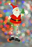 Christmas decoration, santa claus on colorful bokeh background Stock Photos