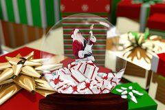 Christmas decoration with santa claus figurine in crystal bowl Royalty Free Stock Photos