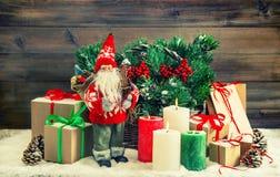 Christmas decoration Santa Claus, gift boxes, burning candles. V Stock Photos