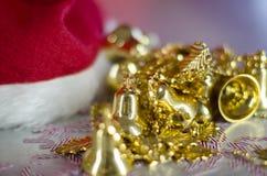 Christmas decoration. Santa Claus hat. Christmas decoration with Santa Claus hat, golden little bells and christmas balls. Christmas composition stock photos