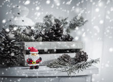 Christmas decoration of santa claus and pine cones on wooden cab Stock Photography