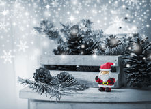 Christmas decoration of santa claus and pine cones on wooden cab Royalty Free Stock Photos