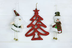 Christmas decoration- santa claus, red christmas tree and snowmam Stock Photography