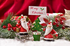Christmas decoration with santa clauses and greetings Stock Photography