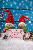 Christmas decoration with santa figurines on wooden background Stock Photo