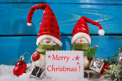 Christmas decoration with santa figurines on wooden background Royalty Free Stock Images