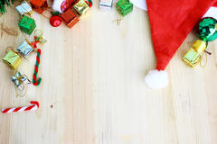 Christmas decoration and Santa's hat on wood background with space for text. Christmas decorations and Santa's hat on wood background with space for text royalty free stock photography