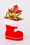 Christmas decoration. In Santa's red boot  on gray background Stock Photos