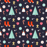 Christmas decoration seamless pattern. Christmas seamless pattern with bell, christmas tree,socks, cookie man, candy stick, heart, star, toys on purple Royalty Free Stock Image