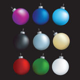 Christmas decoration set. Christmas decorations set of coloured baubles on black Royalty Free Stock Photos