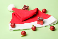Christmas decoration set balls, gifts and Santa hat Royalty Free Stock Images