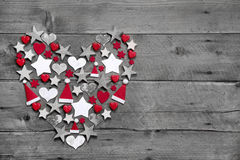 Christmas decoration shaped heart on grey wooden background Royalty Free Stock Photography