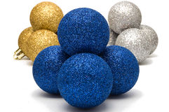 Christmas decoration, the shiny blue balls. Against of gold and silver, isolated on white stock image