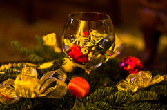 Christmas decoration, shiny colored stars in a glass Royalty Free Stock Photo