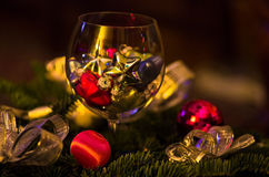 Christmas decoration, shiny colored stars in a glass Stock Images
