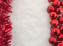 Christmas decoration, red and white. Christmas decoration with shiny red balls and shiny red ornament on a white background Royalty Free Stock Photography