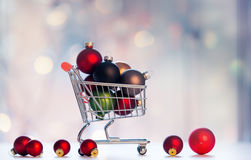 Christmas decoration and shopping cart Stock Image