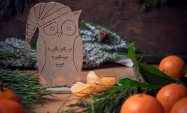Christmas decoration. Silhouette of the owl and tangerines. Stock Photography