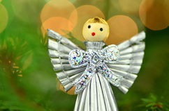 Christmas decoration, silver angel made of straw Stock Image