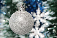 Christmas decoration - silver ball and tinsel Stock Photos