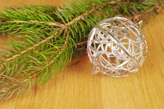 Christmas decoration. Silver christmas bauble and fir twig Stock Photography