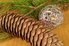 Christmas decoration. Silver christmas bauble and fir twig Royalty Free Stock Images