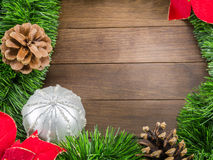 Christmas decoration with silver bauble and poinsettia on wooden Stock Image