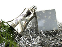 Christmas decoration of silver bell and packet stock photos