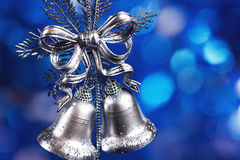 Christmas decoration with silver bells. With blue blurred background Stock Photography
