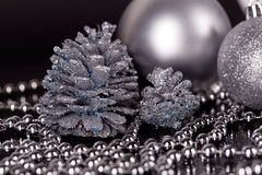 Christmas decoration in silver on black Stock Images