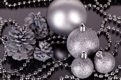 Christmas decoration in silver on black Royalty Free Stock Photography
