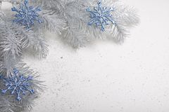 Christmas decoration in silver and blue tones. Star and snowflakes in the Christmas edition Royalty Free Stock Photography