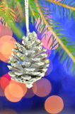 Christmas decoration, silver Christmas cone hanging on spruce twig Stock Photography