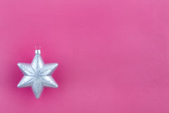 Christmas decoration silver snowflake. On pink background with space for your text Stock Photos