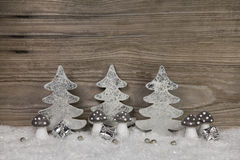 Christmas decoration in silver, white and brown with snow on woo Royalty Free Stock Photography