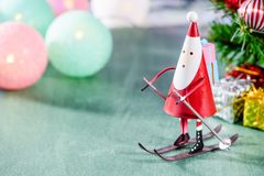 Christmas decoration, skating santa claus, christmas Ambience image. On green background Stock Images