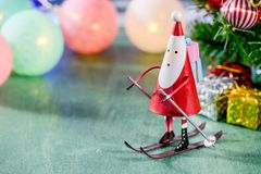 Christmas decoration, skating santa claus, christmas Ambience image. On green background Royalty Free Stock Images