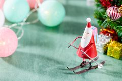 Christmas decoration, skating santa claus, christmas Ambience image. Isolated on green background Stock Photography