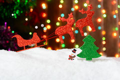 Christmas decoration sleigh and reindeer in the snow Stock Images
