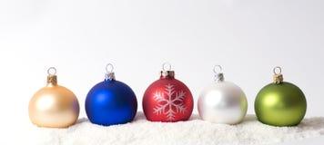 Christmas decoration on snow. Christmas glass ball on snow Royalty Free Stock Photos