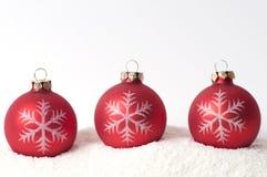 Christmas decoration on snow. Christmas glass ball on snow Stock Images