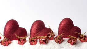 Christmas decoration on snow. Christmas red decoration on snow Royalty Free Stock Photos