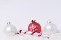 Christmas decoration on snow. Christmas glass ball and  decoration on snow Stock Photos