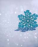 Christmas decoration on snow. Against blurred lights background Stock Photos