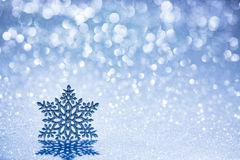Christmas decoration on snow. Against blurred lights background Stock Photo