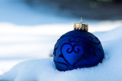 Christmas Decoration in Snow. Blue Christmas decoration nested in snow. Christmas Card Royalty Free Stock Photo