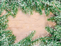 Fir branches on texture wood background, top view Royalty Free Stock Images